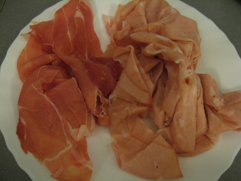 How to make tortellini: Chop mortadella and prosciutto