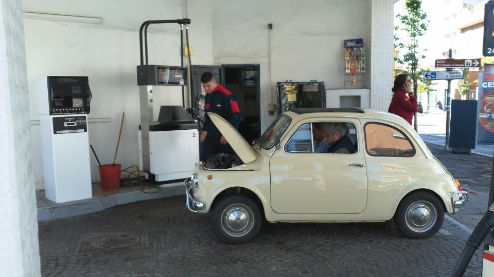 Vintage Fiat 500 at the gas station with three men!