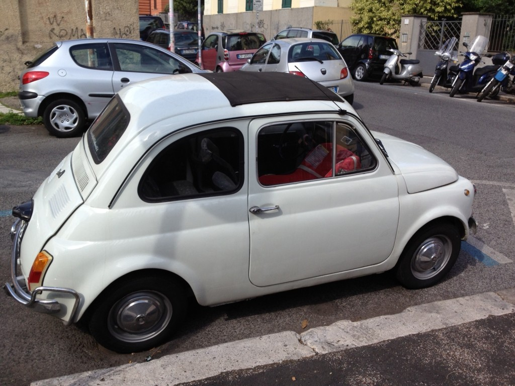 White Vintage Fiat 500: Car Seat Inside