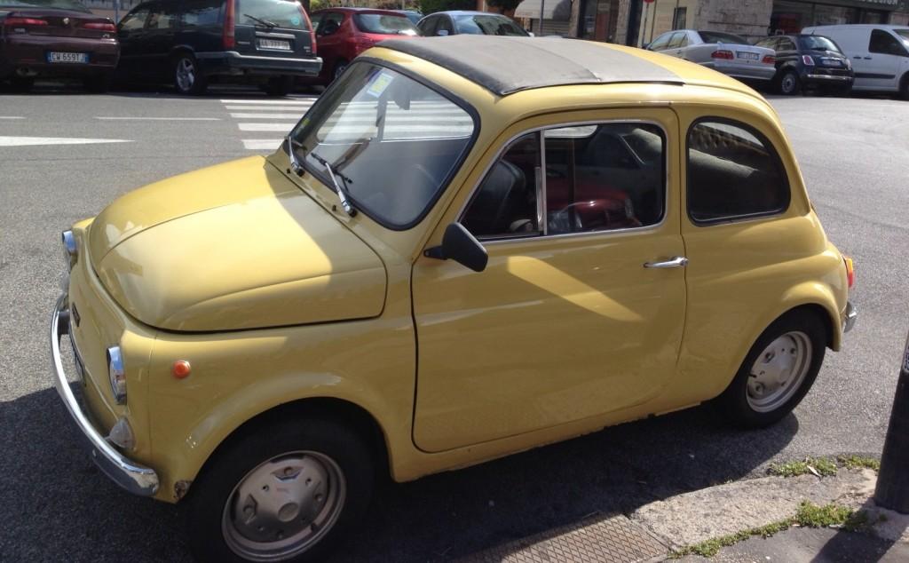 Yellow Vintage Fiat 500 - Corner of the White Fiat 500